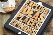 explore ideas, places and opinions - motivational words in vintage wood type on a digital tablet with a cup of coffee and cookie