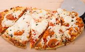 Fresh Hot Sliced Oval Pizza
