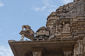 Sculptor At Top Of Vishvanatha Temple, Khajuraho, India - UNESCO world heritage site.