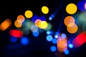 Colorful Led (light Emitting Diodes) Lights Garland With Bokeh Effect On Black Background