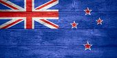 picture of zea  - flag of New Zealand or banner on wooden background - JPG