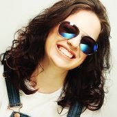 funny curly woman with sunglasses, emotional picture