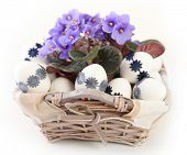 white easter eggs and blue flowers