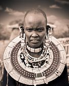 TANZANIA, AFRICA-FREBOARY 9, 2014: Masai woman with traditional  ornaments, review of daily life of