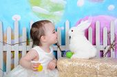 Sweet Toddler Girl With Bunny At Easter