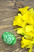 beautiful scratched handmade Easter egg and daffodil flowers