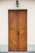 foto of front-entry  - Old fashioned front door entrance to the church all in dark brown colors Europe - JPG