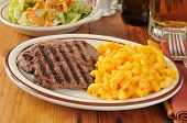 image of cheese-steak  - Grilled cube steak with macaroni and cheese and a mug of beer - JPG