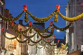 picture of galway  - Shop street at night illuminated with Christmas lights Galway Ireland - JPG