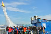 SOCHI, RUSSIA - FEBRUARY 12, 2014: Fans in the line to booking offices in Olympic Park against Olymp