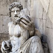 foto of cornucopia  - Roman representation of Tiber as a god (Tiberinus) with cornucopia at the Campidoglio Rome.