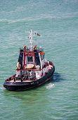 Tugboat Motoring Away