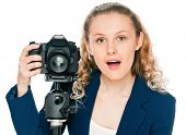 Excited young woman shouting a camera