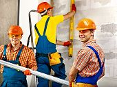 foto of millwright  - Happy group people in builder uniform - JPG