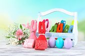picture of ear candle  - Composition with funny handmade Easter rabbits in wicker basket - JPG