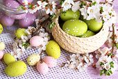 Composition with Easter eggs and blooming branches, close-up