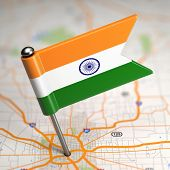 India Small Flag on a Map Background.