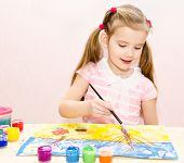 Cute Smiling Little Girl Drawing With Paint And Paintbrush
