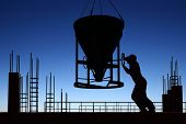 Silhouette of worker and construction