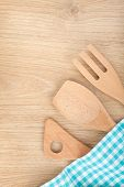 Kitchen utensils on wooden table