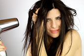 Beautiful Female Model Drying Long Messy Hair
