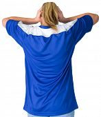 Disappointed football fan in blue on white background