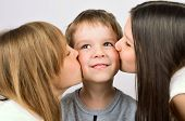 Two Girls Kissing Little Smiling Boy