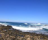 Turbulent Ocean Waves With White Foam Beat Coastal Stones, Fuerteventura, Canary Islands At La Pared