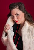 Pinup Girl Poses In Fur Coat