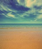 beautiful landscape with gold sand beach and sea - vintage retro style