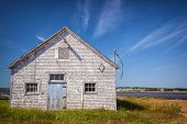 Old building on Atlantic shore in North Rustico, Prince Edward Island, Canada.