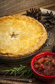 Traditional pork meat pie Tourtiere with apple and cranberry chutney from Quebec, Canada.