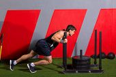 stock photo of sled  - sled push man pushing weights workout exercise at gym - JPG