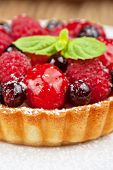 Cake with fresh berries and mint closeup