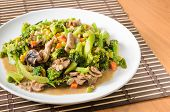 Stir fried Broccoli Carrot Sweet corn Green Bean and Onion with pork. Vegetarian food