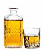 Glass jars with whiskey and ice on white background
