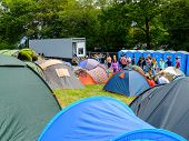 Campers queuing for the showers at the campsite during 'Festival No.6'