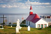 Chapel of Tadoussac, historical monument built of wood in 1747. The red-roofed Chapel overlooks the St Lawrence river. Quebec, Province, Canada.