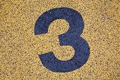 Number Three Sign On Sand Fome