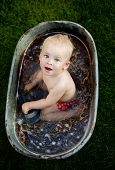 Little boy bathing outside