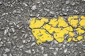Close-up Of Yellow Line On Road Texture