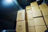 stock photo of moving van  - Pile of Boxes in a Cargo Van Closeup - JPG