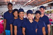 foto of factory-worker  - group of happy clothing factory workers inside production area - JPG