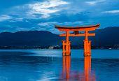 Great floating gate (O-Torii) on Miyajima island near Itsukushima shinto shrine, Japan shortly after the sunset