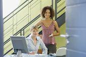 Multi-ethnic businesswomen behind desk