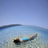 stock photo of pacific islander ethnicity  - Pacific Islander woman laying in ocean - JPG
