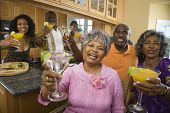 African seniors toasting at party