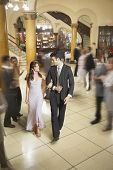 Young Hispanic couple walking arm in arm