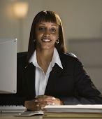 African businesswoman sitting at desk