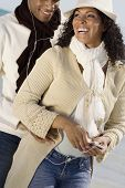 Multi-ethnic couple listening to mp3 same player